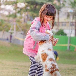 portrait-of-a-smiling-young-woman-with-dog-332974